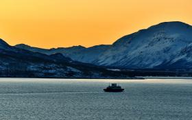 Ship with mountains and orange sky